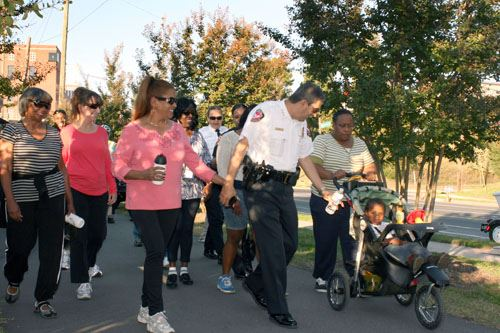 Police Officer walking with Citizens on Trail