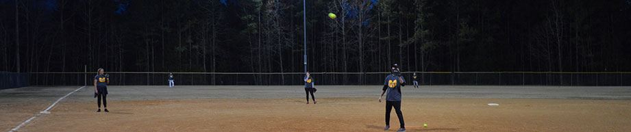 Adult hitting softball