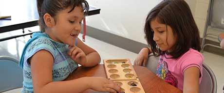 Little Girls Playing Mancala