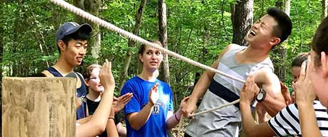 People participating in a low ropes course
